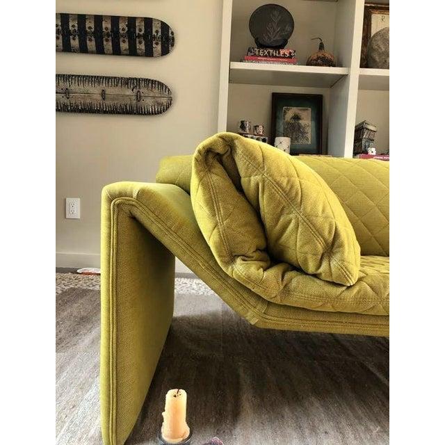 Vintage mid-century chaise lounge upholstered in Adelene Simple Cloth's Plush Crush Egg Yolk fabric. Loose cushion...