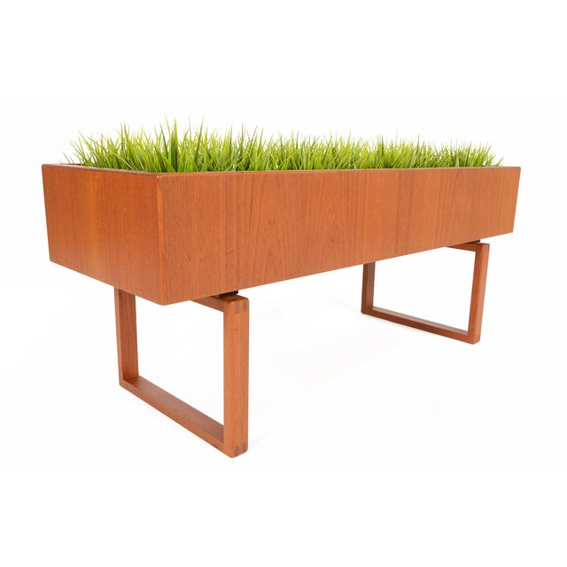 This gorgeous teak planter was designed by Kai Kristiansen for Salin Møbler in the 1960s. The long teak case is supported...