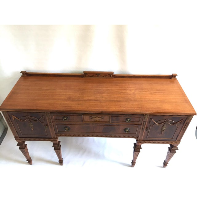 A beautiful and near perfect antique mahogany sideboard that has been completely restored to a natural low sheen finish. A...