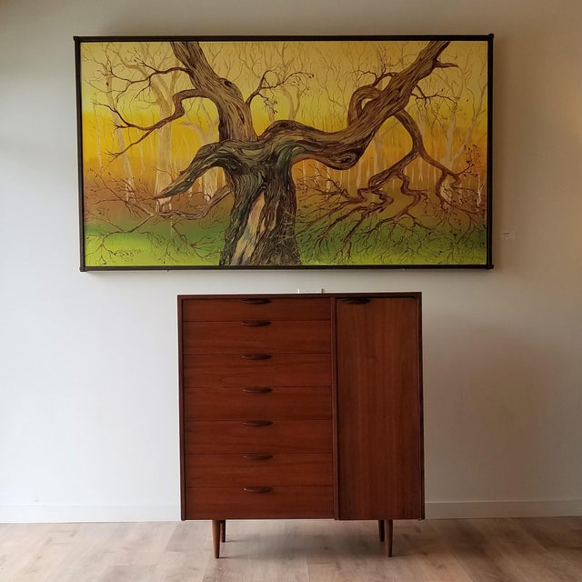 A stunning Mid-Century Modern Teak gentleman's chest made in Denmark. This chest has a total of nine drawers (7 exterior,...