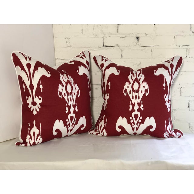 Fabulous pair of Jim Thompson ikat reversible pillows, in white on red and red on white, printed on a waxed linen. The...