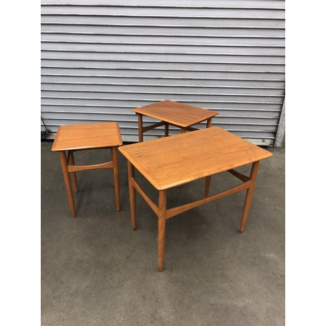 Stunning refinished set of solid teak nesting tables by Kai Kristiansen for Skovmand and Andersen, circa 1960. Can be used...