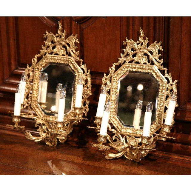 This elegant pair of wall hanging bronze sconces were crafted in Paris, France circa 1860. Each of the decorative, ornate...