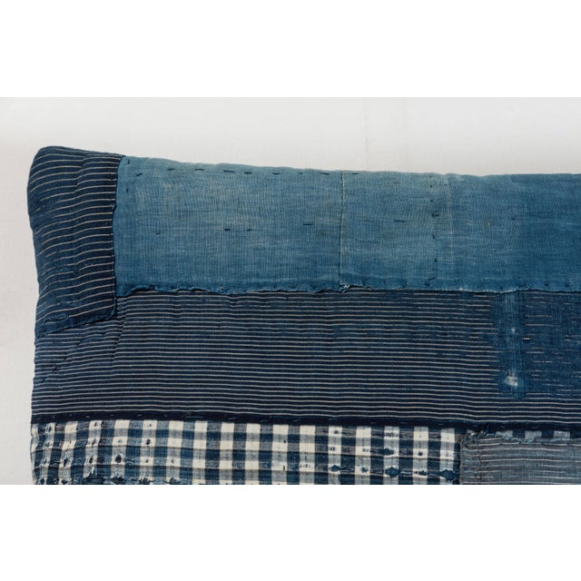 19th century Japanese patchwork indigo cotton reconfigured into a pillow with blue linen back, invisible zipper closure...