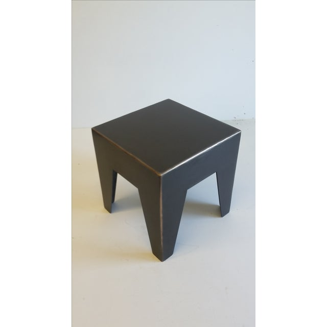 Steel sheet metal assembled with bronze. Antic black patina with bronze accents. A small, practical and elegant...