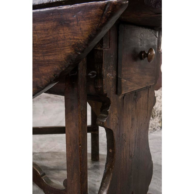An Exceptional Italian Baroque Drop Leaf Table, 19th century, walnut, having outstanding patina, the rectangular frame...