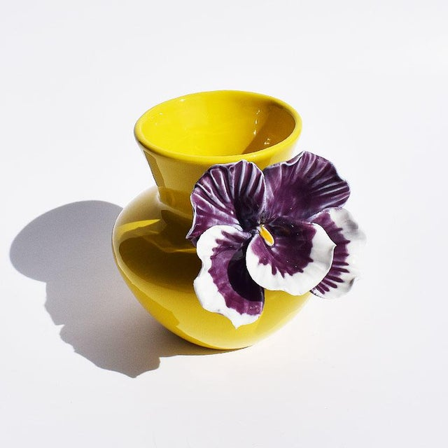 Bold colorful and sculptural yellow ceramic vase with bright purple orchid decoration. Urn shape in form, this Spring...