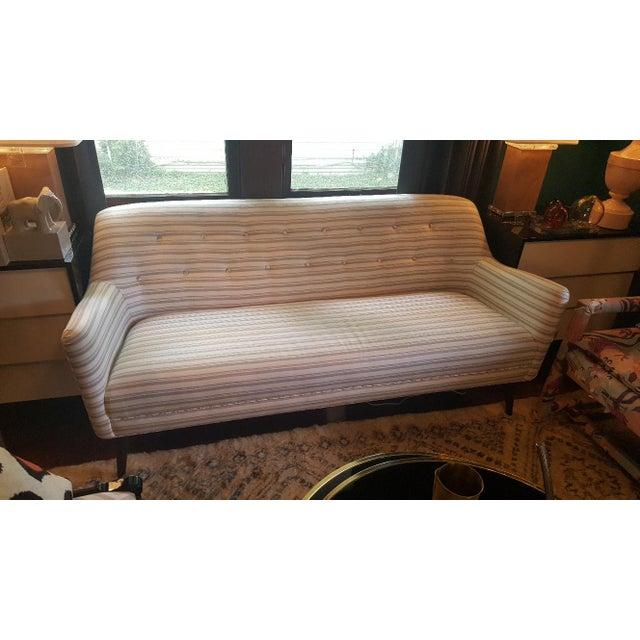 Suri sofa by Precedent Furniture with Schumacher Capri beige/ white striped fabric. Tight seat and back. Botton accents on...
