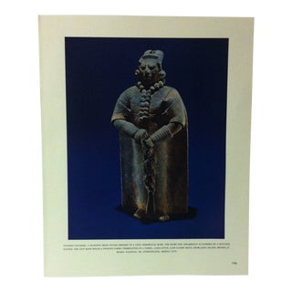 """Circa 1960 """"Pottery Figurine - a Standing Male Figure Dressed in a Long Ceremonial Robe"""" Treasures of Ancient America Mounted Print For Sale"""