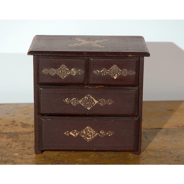 19th century miniature chest of drawers in original paint.