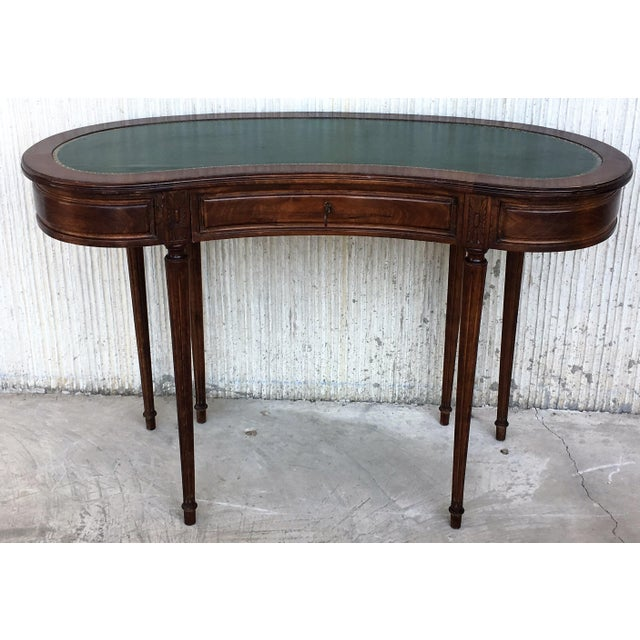 About A fine quality Coromandel Victorian style kidney shaped writing table. The kidney shaped top having a fine quality...