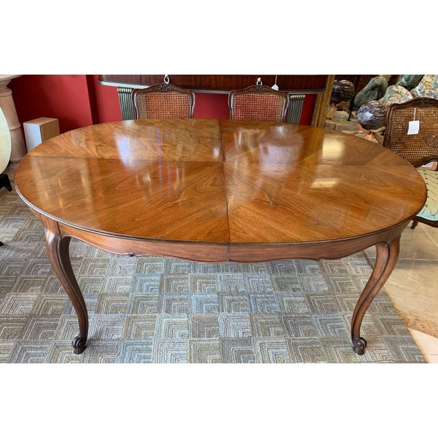 Samll scale, dainty and graceful Italianate Louis XV style dining set made by Kindel. The oval table is topped with...
