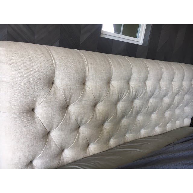 The style, construction and comfort of a fine Chesterfield sofa, brought to the bedroom and sloped to a most inviting...