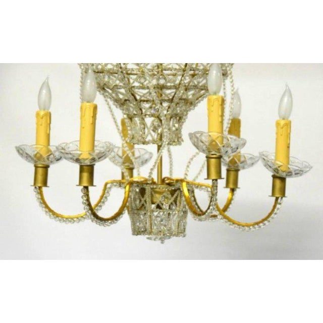 Hot air balloon form chandelier. Gilded metal effect frame with 6 lighted arms and a crystal bead decoration.