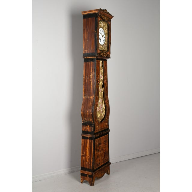 A beautiful 19th century country French comtoise, or grandfather clock, with polychrome painted pine case and embossed...