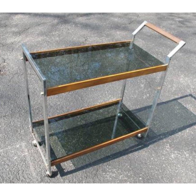 """condition: excellent size / dimensions: 31"""" x 14"""" x 30"""" this is a vintage 1970's mid-century modern rolling bar cart Its..."""