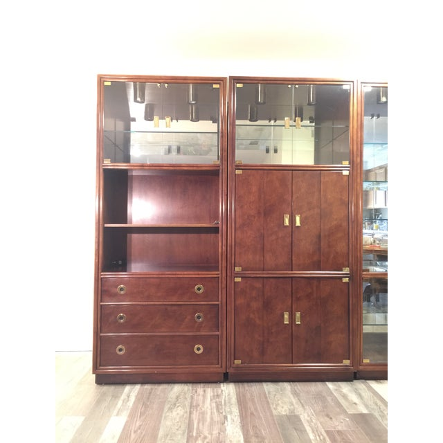 Beautiful wall unit set from the widely acclaimed Henredon Fine Furniture Company. The set consists of a pair of bookcases...