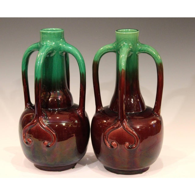 Antique pair of Awaji vases in great, organic Art Nouveau form, each with two pair long, swooping tendril handles, circa...