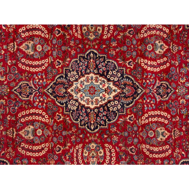 Vintage hand-knotted Persian Tabriz rug with a medallion motif. This piece has great detailing and a beautiful design, low...