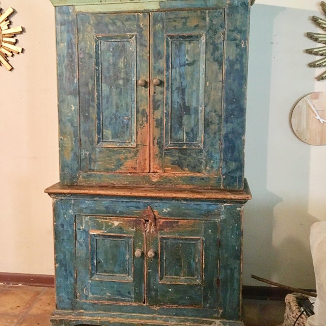 This cupboard is over 100 years old and retains its original blue paint. The piece features double doors on the top and...