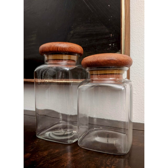 Fabulous for a minimalist or Danish Modern kitchen, this set features solid teak mushroom-shaped lids and crystal clear...