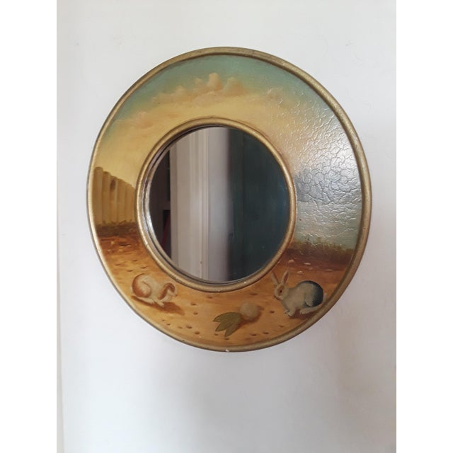 This stunning mirror. The round frame of hand painted rabbits is joyous to have on you wall.