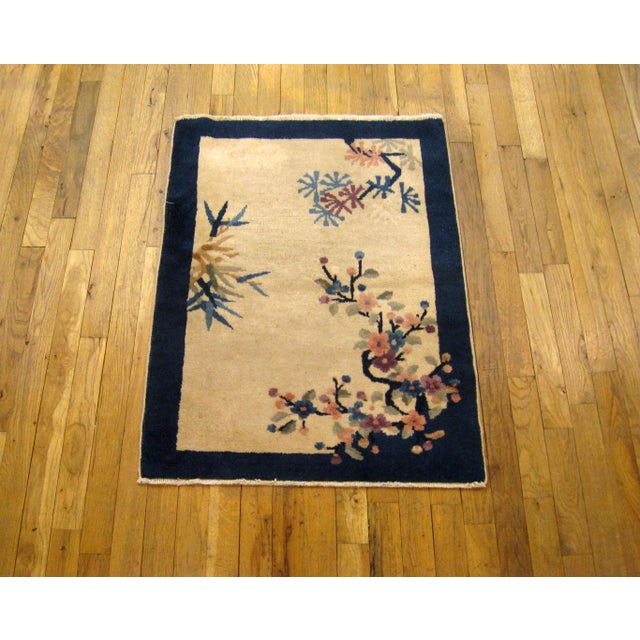"""An antique Chinese Peking oriental rug, size 3'0"""""""" x 2'2"""""""", circa 1900. This lovely hand-knotted oriental carpet features..."""