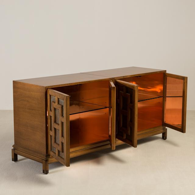 An Asian Modern four-door cabinet designed by Renzo Rutili with Fretwork style Paneling with acid etch metalwork, 1960s,...