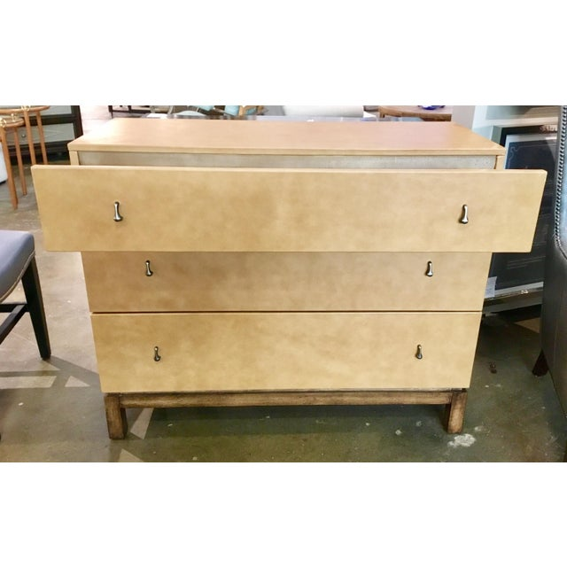 Original Retail $3000, Modern three drawer Drexel Heritage Co. tan leather chest with brushed nickel tear drop pulls and a...