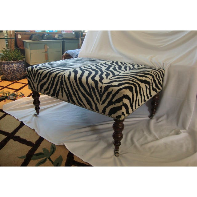 Ralph Lauren style zebra print upholstered ottoman. A beautiful zebra print and over-sized ottoman. Great design with...