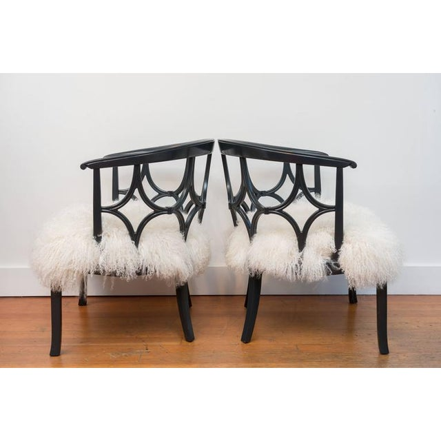 Beautiful pair of dark grey lacquered chairs reupholstered in Mongolian sheepskin