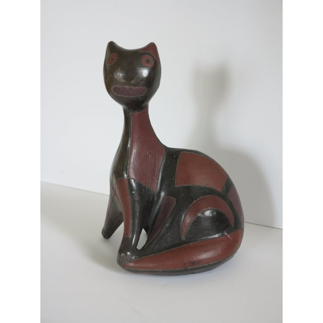 A quite wonderful and rare 1950s pottery cat with abstract geometric coloring by Mexican artist Manuel Felguerez Barra....