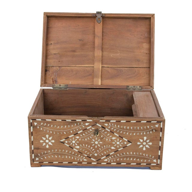 Gorgeous bone inlay work with its intricately carved work and fine details are the highlight of this antique merchant box....