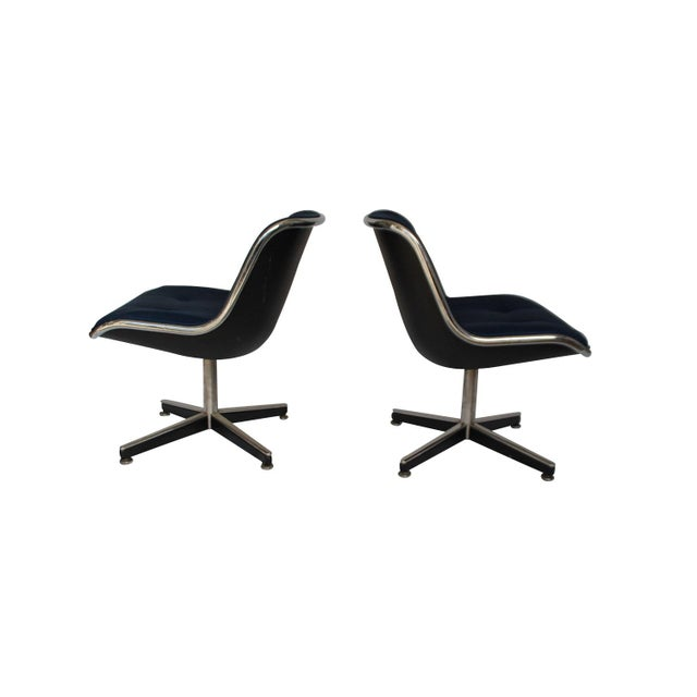 Pair of Knoll swivel chairs in original navy fabric. Heavy cross base and chrome detail.