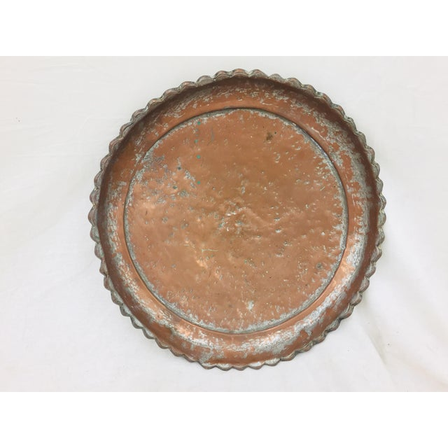 Stunning Antique Pounded Copper Tray from Turkey. Fabulous hung or used as a serving platter. Gorgeous pie crust detail at...
