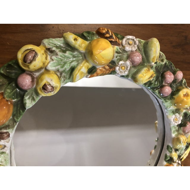 This mirror is a stunner just because of its European style and bright colors. It was made in Italy, probably in the mid...