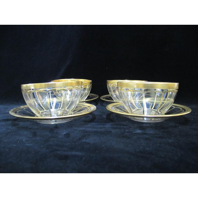 Beautiful vintage glassware set of 4 soup bowls and saucer (8 pieces total) each in clear glass with gold gilt design....