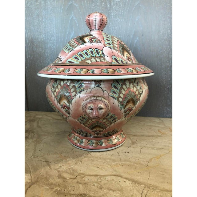 Pink decorative ceramic jar. Roughly 13 inches wide (radius of 6.5 inches) and 11 inches tall.