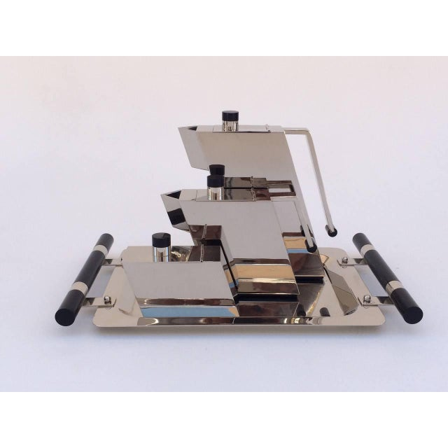 An Italian polished nickel with black acrylic handles tea set. Designed by Punto Bacola for Montagnani, circa 1980...
