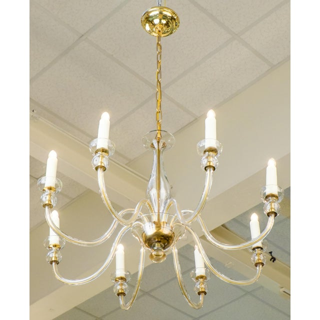 This Italian Murano amber glass eight-arm chandelier is a perfect piece for dining rooms, foyers, and seating areas. A...
