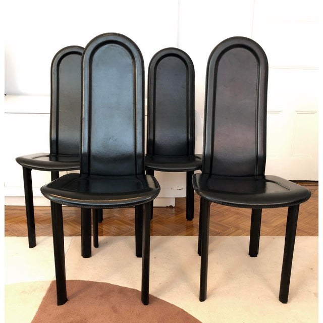 Immaculate set of four fully upholstered black leather Artedi dining chairs. Simple, modern lines typical of 80s and 90s...