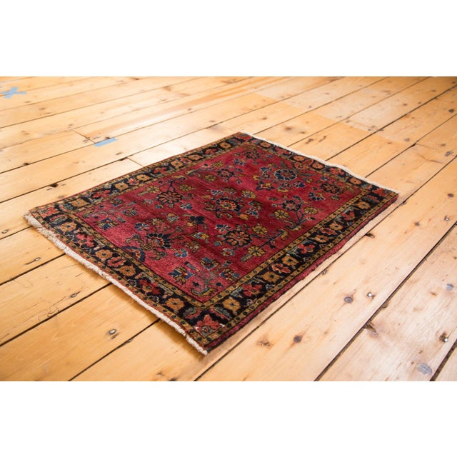 Sweet little vintage Mohajeran Sarouk rug mat with allover floral bouquets. Wonderful maroon red, deeply saturated and...