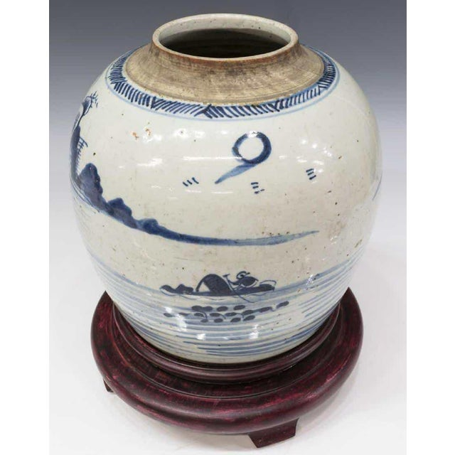 Classic Chinese blue and white porcelain covered melon jar from early to mid 1900s. Hand drawn depiction of a temple...