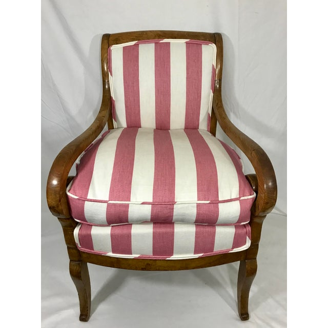 Solid Burled Walnut Charles X arm chair newly upholstered in a whimsical framboise stripe. We added a removable cushion to...