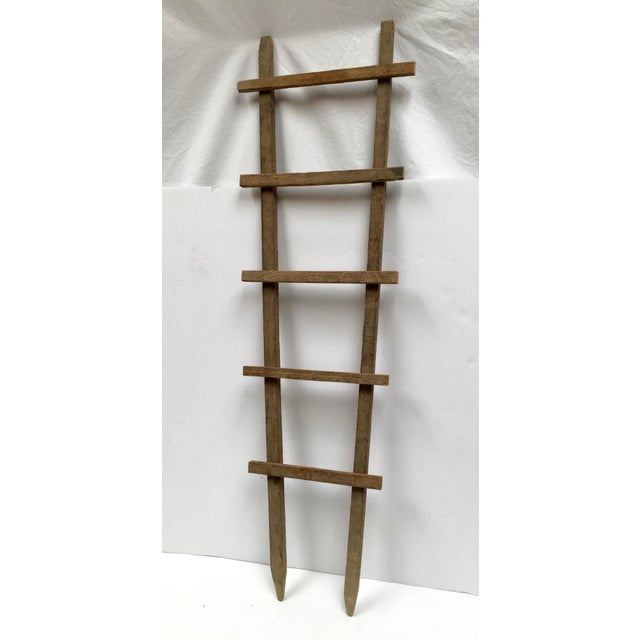 Vintage hand crafted tobacco drying sticks repurposed as a decorative ladder. A perfect accessory in your bathroom or...