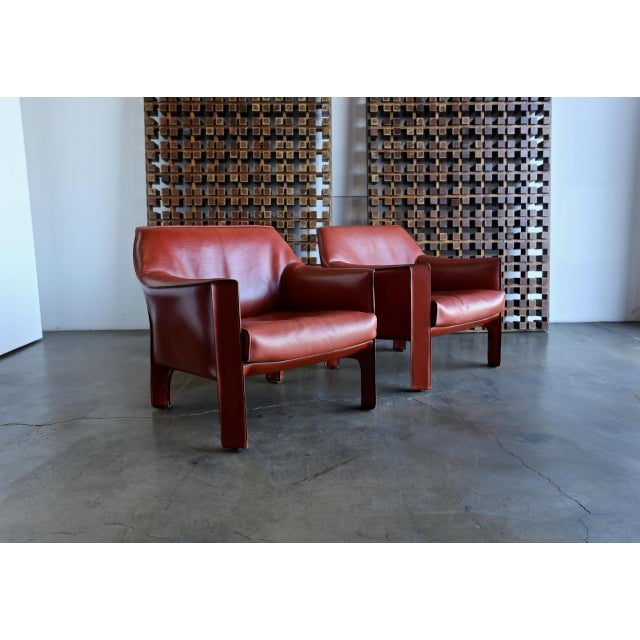 Pair of large CAB red leather lounge chairs designed by Mario Bellini for Cassina. This is the largest chair designed for...