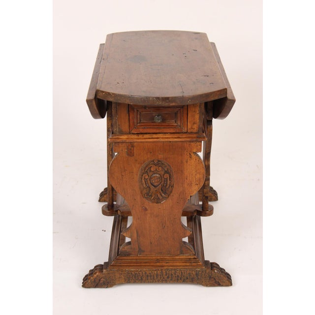 Baroque style walnut drop leaf end table, made from 18th century and later elements, assembled circa 1930. This table has...