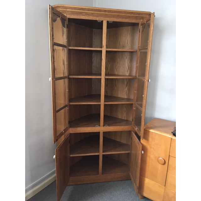 This beautiful corner cabinet is made from solid oak wood. It was hand crafted by an Amish furniture builder in Prebble...
