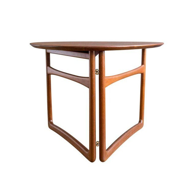 A model FD 18/57 teak folding or side table designed by Peter Hvidt and Orla Mølgaard-Nielsen for France & Daverkosen,...