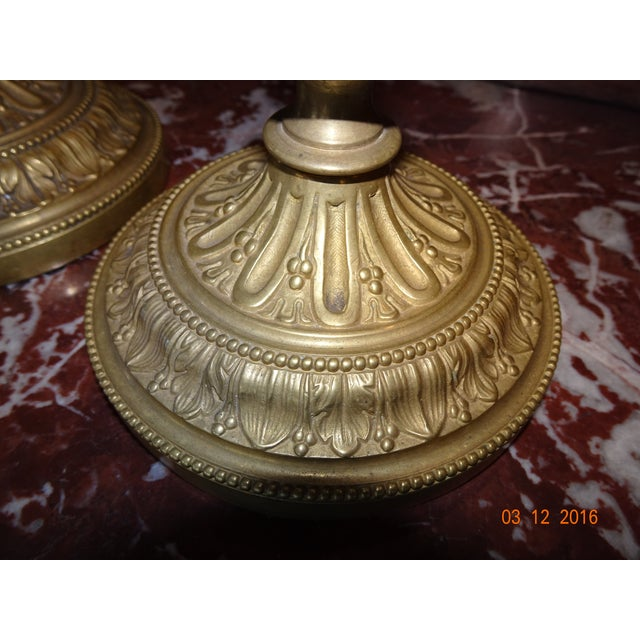 Charming pair of 19th Century French brass candle holders.